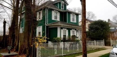 65 Woods Ave, Roosevelt, NY 11575